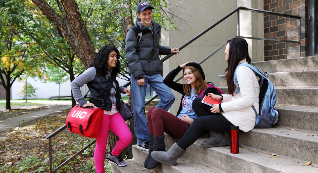 UIC students talking on a staircase