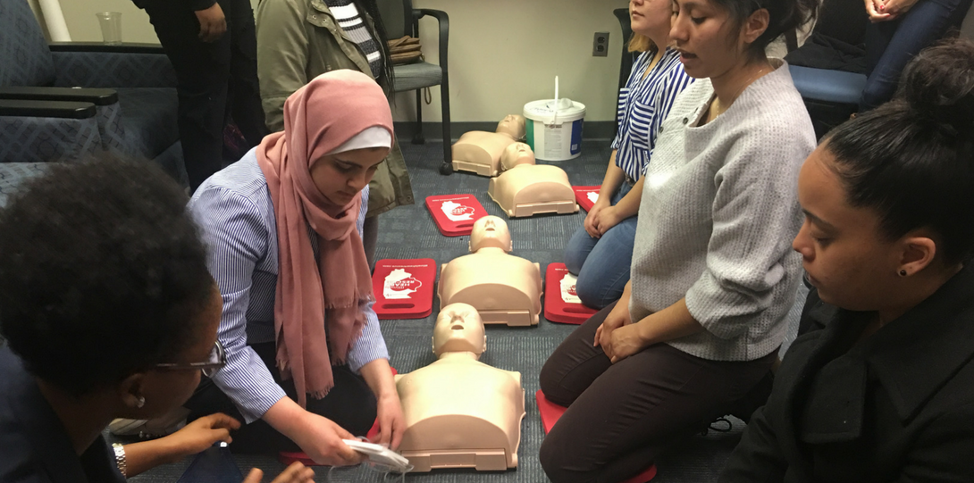 Students engaging in CPR