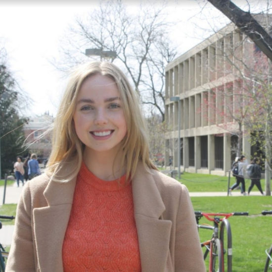 student smiling on campus